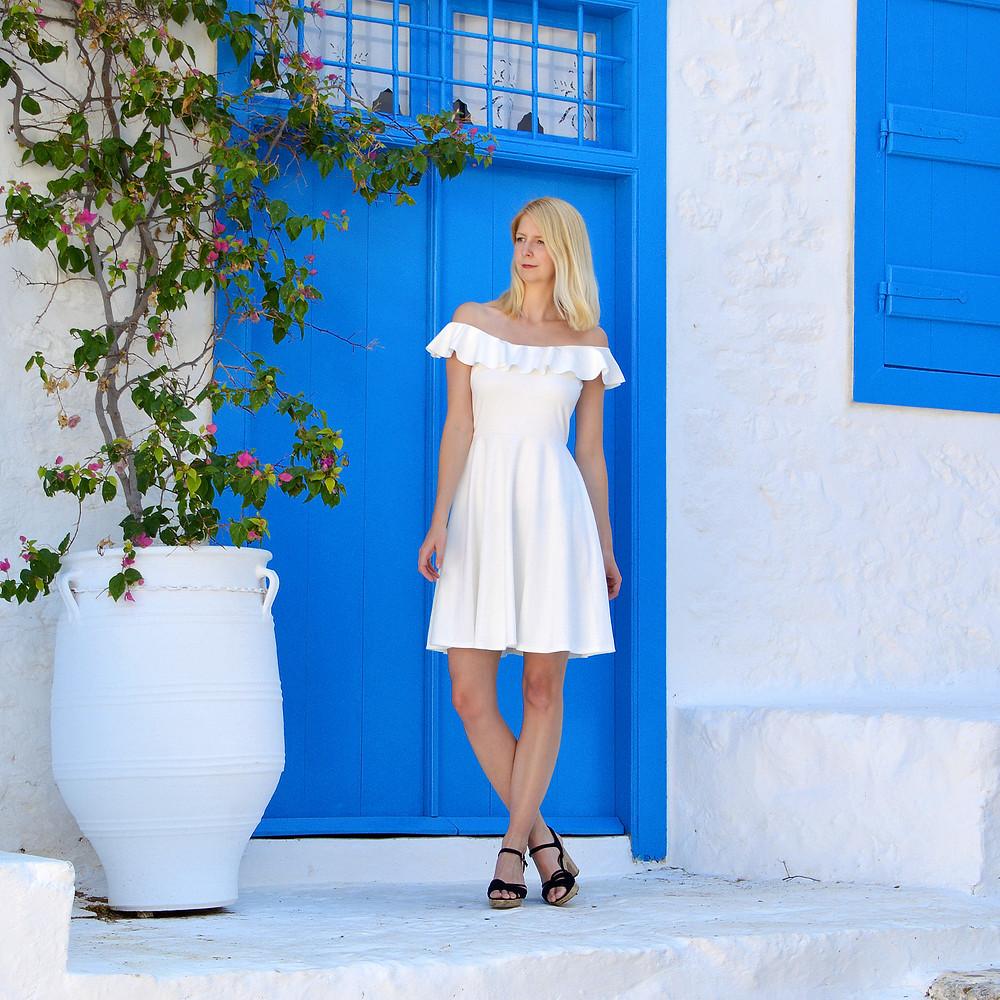 White summer dress with neckline ruffle