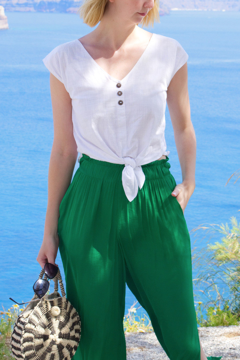 Summer outfit with white blouse and green trousers