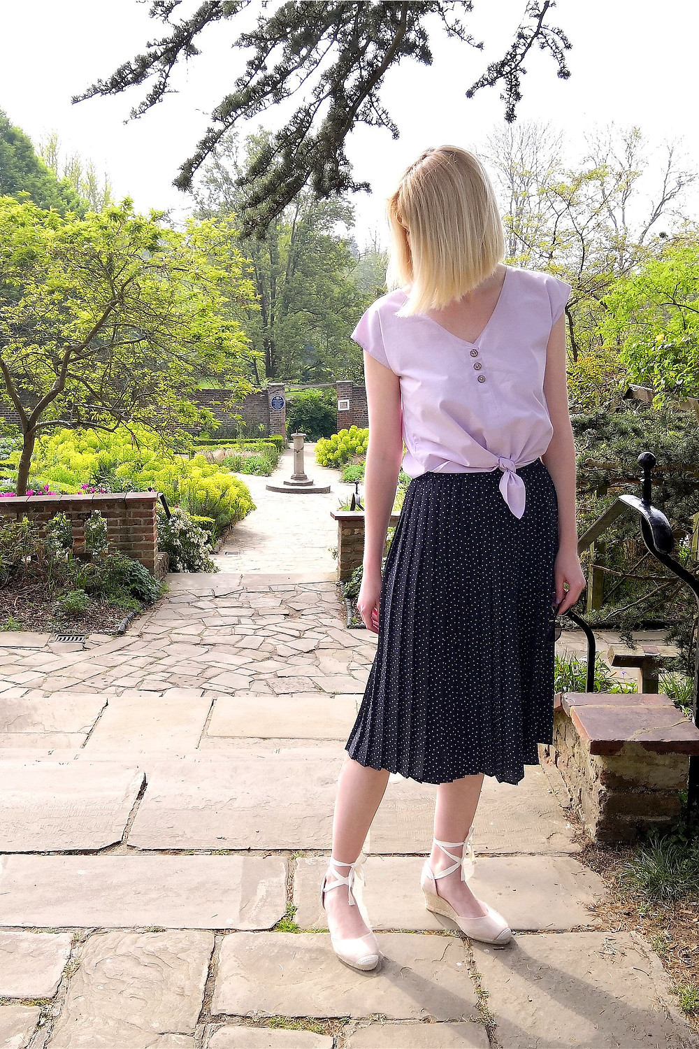 Spring outfit with vintage tie up blouse, pleated midi skirt and wedges