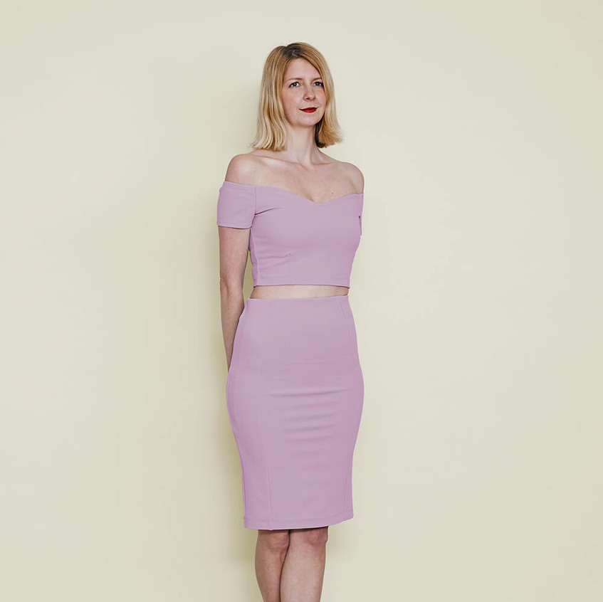 With off shoulder top and pencil skirt in pastel lilac