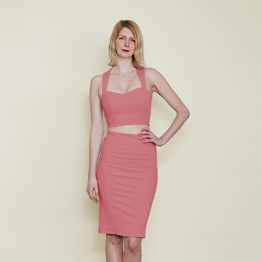With sweetheart bralet and pencil skirt in pastel pink