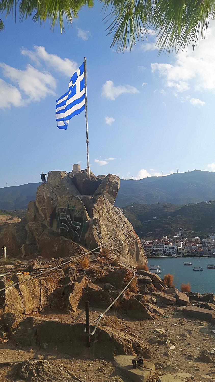 The Greek flag at Poros clock tower