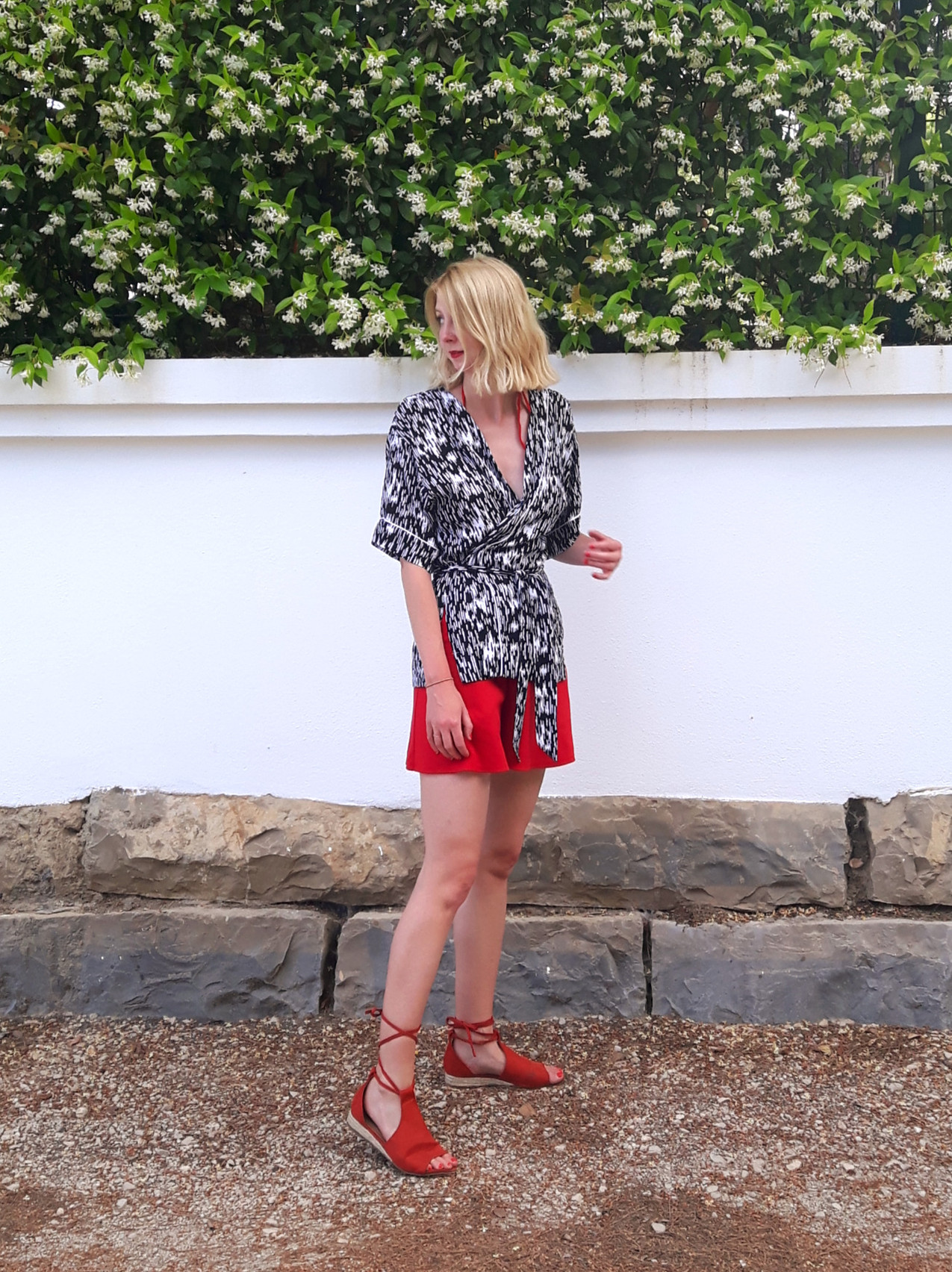 Summer outfit of kimono wrap top with shorts and sandals