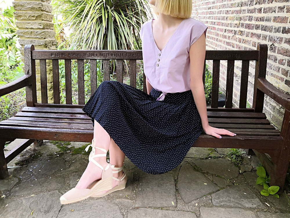 Spring outfit detail with midi skirt and tie up wedges