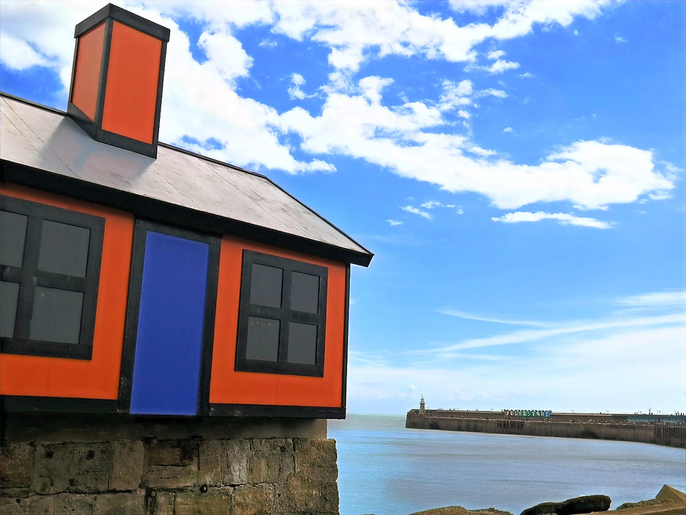 'Holiday Homes' by Richard Woods and the Folkestone sign in the distance by Patrick Tuttofuoco