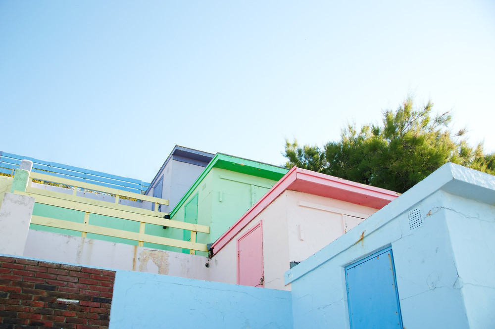 Pastel-washed beach huts in Folkesone
