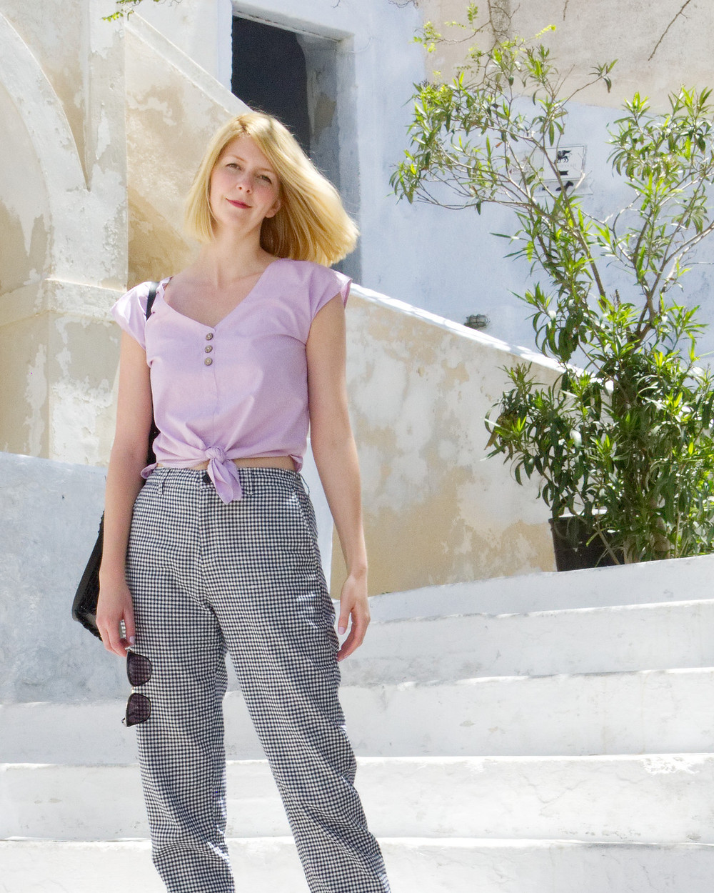 Lilac blouse with gingham check trousers