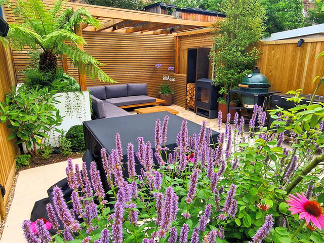 Small Family Garden with Oak Pergola, Terrace and Generous Dining and Seating Area