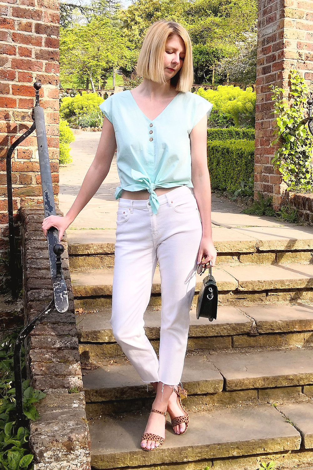 Spring outfit with animal print, white denim and mint green blouse