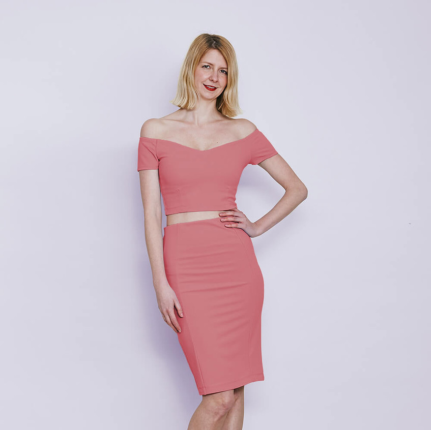 With off shoulder top and pencil skirt in pastel pink