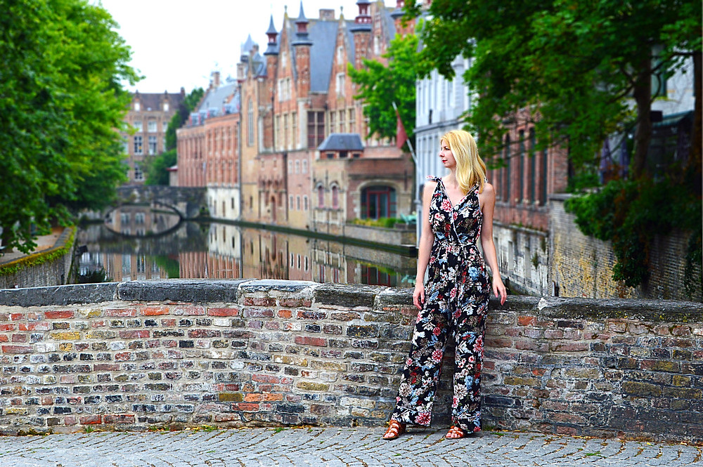 Stylecamp floral jumpsuit worn on the bridge in Bruges