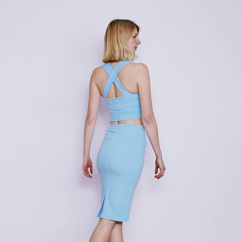 With sweetheart bralet and pencil skirt in pastel blue