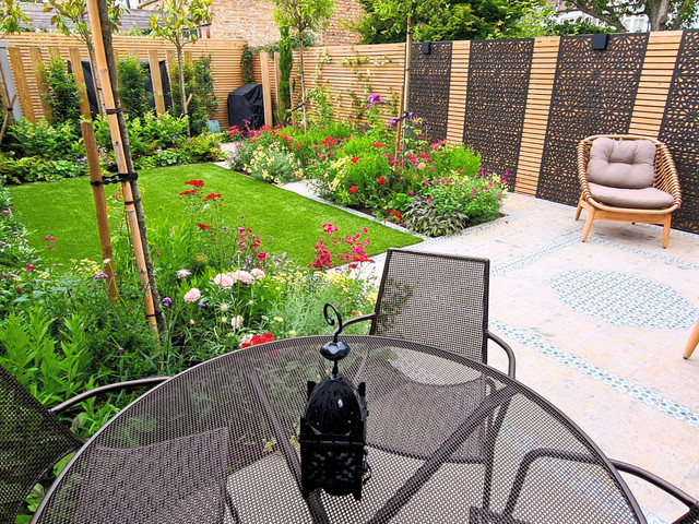 A Wonderful Islamic-Influenced Family Garden with Colourful Beds and Decorative Tiling