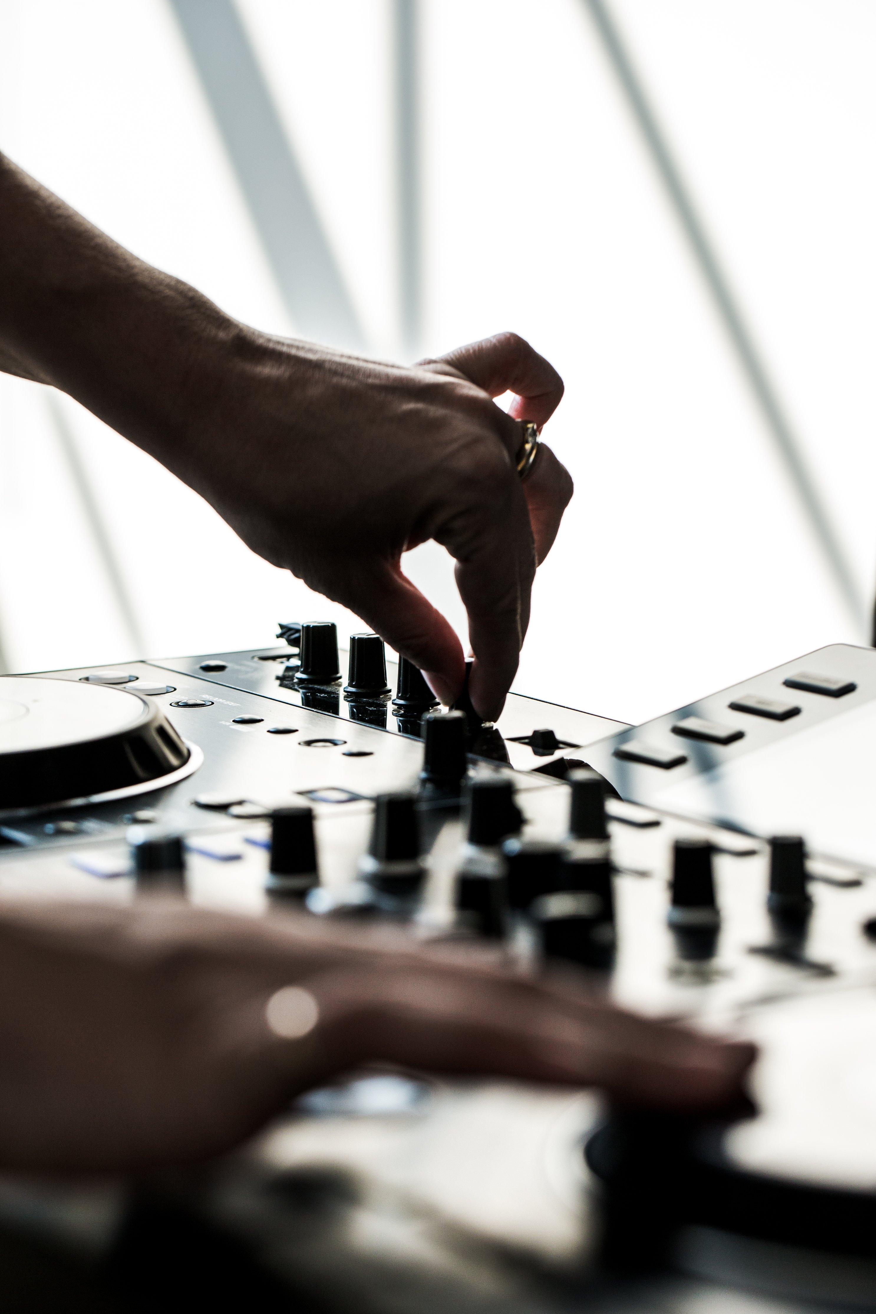 hands-using-dj-board