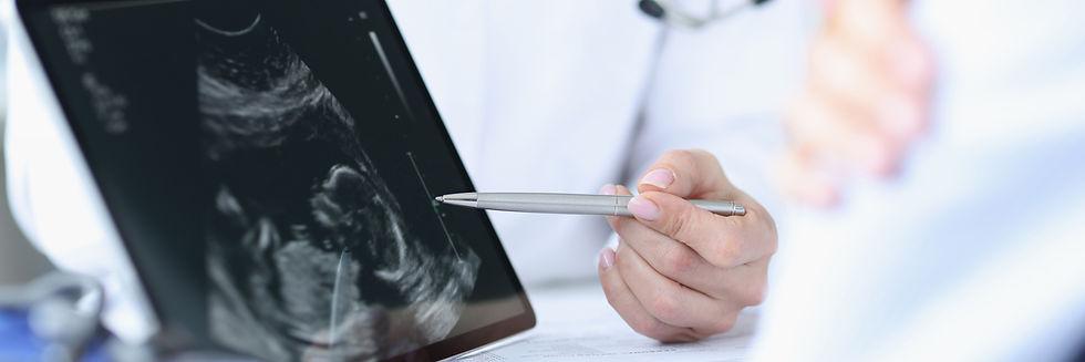doctor-demonstrates-fetal-ultrasound-on-tablet-screen-medical-examination-during-pregnancy