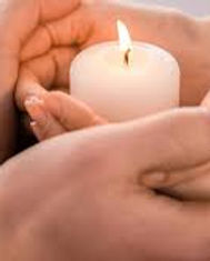 candle in hands.jpg