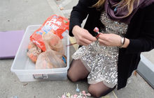 Charlotte attaching candy to a sculpture
