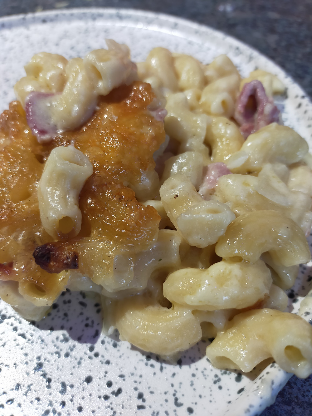 Mac n Cheese cooked in a wood fired outdoor oven tastes so good, the extra flavoring takes it to the next level.