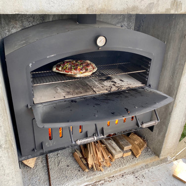 The Kiwi Outdoor Oven / Outdoor Fire Built in with a massive chimney.jpeg