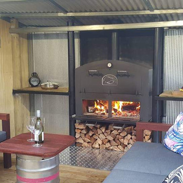 Large outdoor oven / outdoor fire built in an outside entertainment room