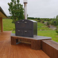 A Kiwi Outdoor Oven large Outdoor Oven / Outdoor Fire on a custom built deck platform