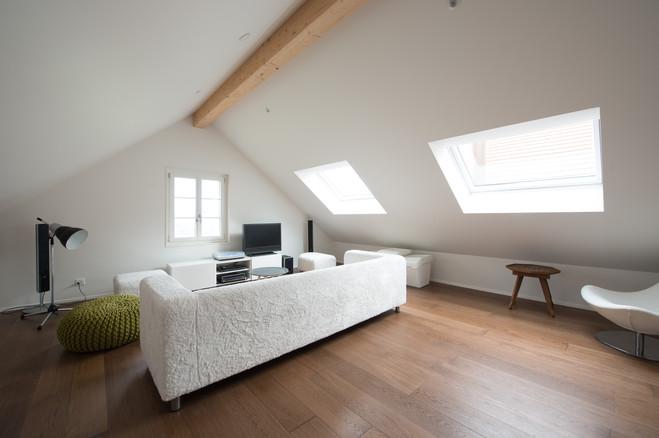 salon sous attique boite noire©tangram architectures.jpg