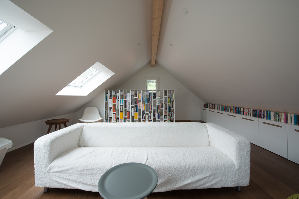 salon sous attique face boite noire©tangram architectures.jpg