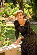 Shirley sitting in garden.jpg
