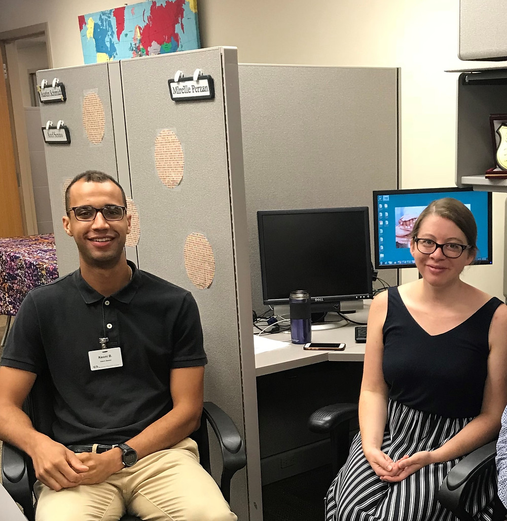 Keoni Bailey (Marquette, Aurora Research Institute) and Mireille Perzan (UWM Zilber School of Public Health) working in the MGHC office on study design and data collection.