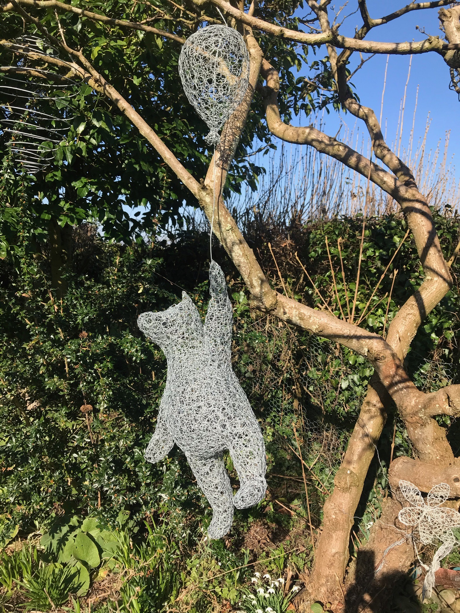 Wirework Winnie the Pooh, floating away