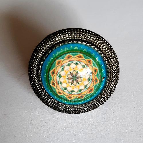 טבעת מנדלה בצבע טורקיז עם פרח חום