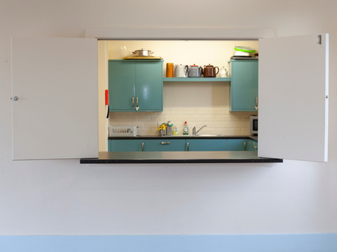 Serving hatch from the hall to the kitchen