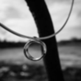silver swirl pendant on torque