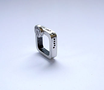 'they were like pins in paper'curved square hollow silver ring, photo etched