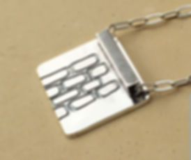 photoetched brick necklace