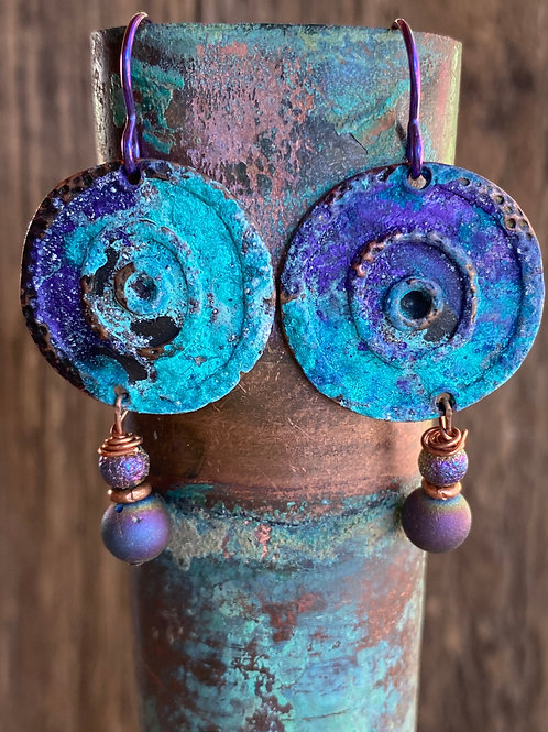 Copper spiral disc earrings with an organic verde green and purple patina