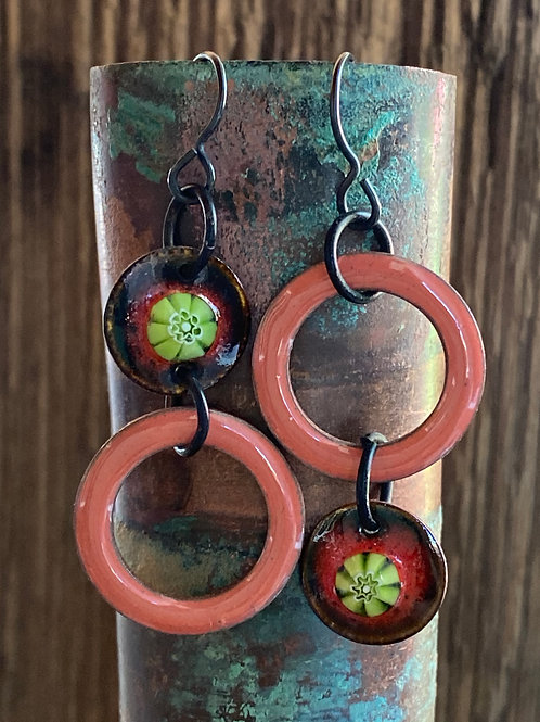 Asymmetrical enameled earrings in peach, green and black
