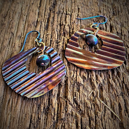 Corrugated texture on  copper  earrings flame painted