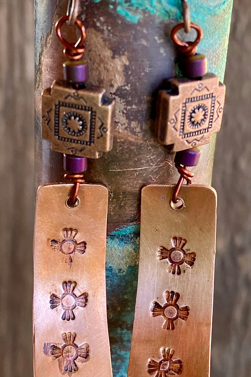 Metal Stamped copper earrings  with a southwest flair