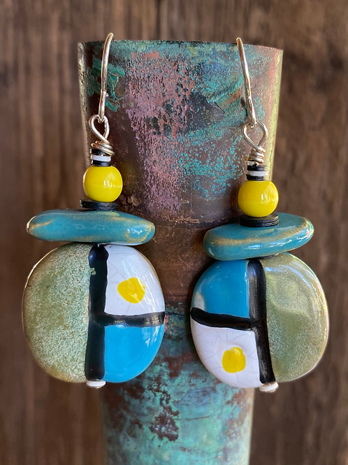 Geometric patterned ceramic bead earrings in blue, black and yellow