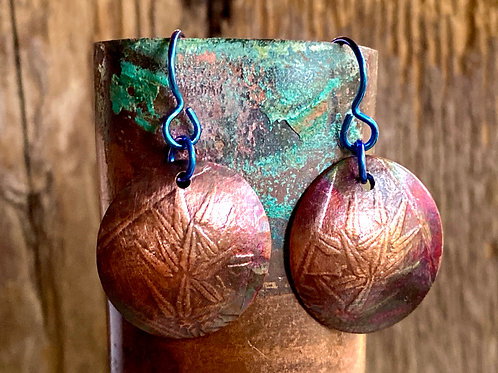 Embossed copper  earrings with a floral pattern