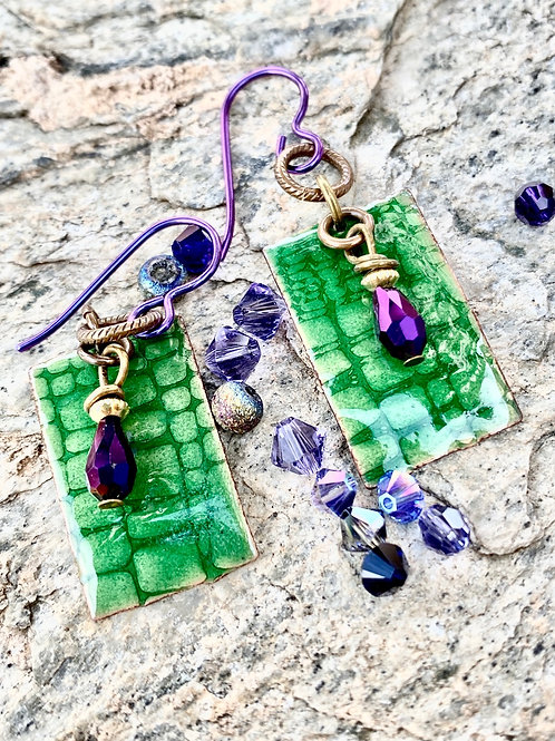 Embossed Copper Enameled Earrings - Transparent green with purple accents.