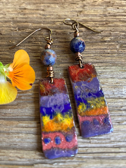 Enameling glass handpainted on copper in shades of red, orange, blue and yellow