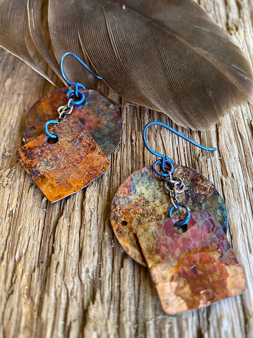 Textured copper dangles with a flame enhanced patina