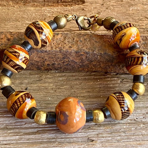 Lampwork Glass Bracelet in shades of brown, Cream and Black with brass accents.