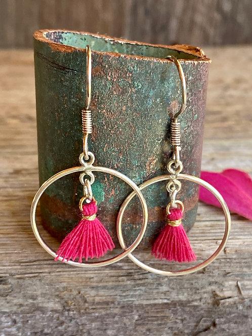 Sterling silver hoop earrings with bright fuchsia tassels