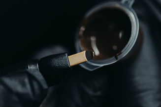 A close-up brown pigment is applied to t