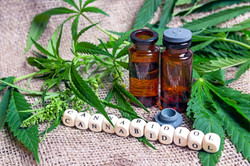 Bottle%2520with%2520hemp%2520oil%2520and%2520cannabis%2520leaves%2520on%2520burlap.%2520Medical%2520