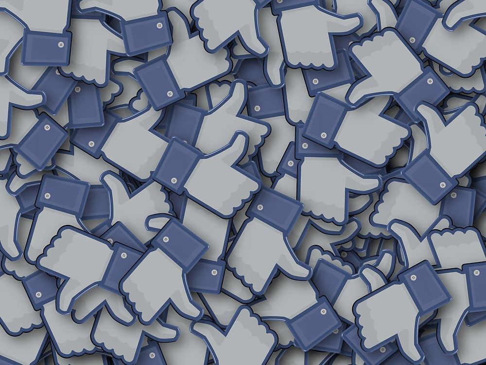facebook likes blue thumbs up