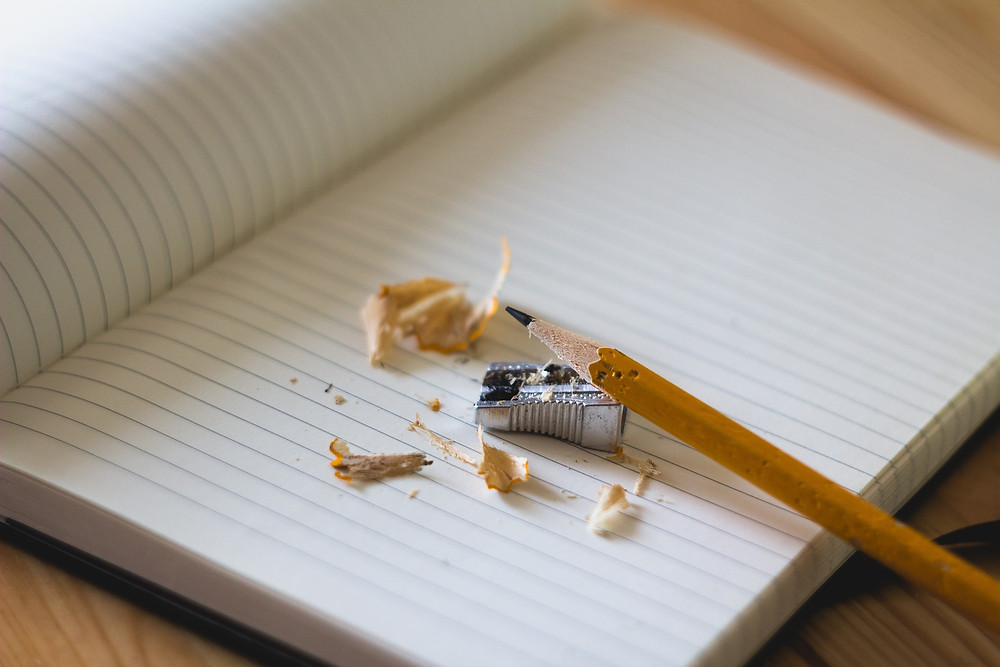 Sharpened pencil and notebook ready to write